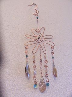 Windchime.  beads, shells & white wire coat hangers would work...