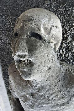 Pompeian victim from the 79AD eruption of Mount Vesuvius.  Note how the teeth still remain in place- this was due to the volcanic ash which layered the fallen victims, which preserved them in their exact positions and locations.