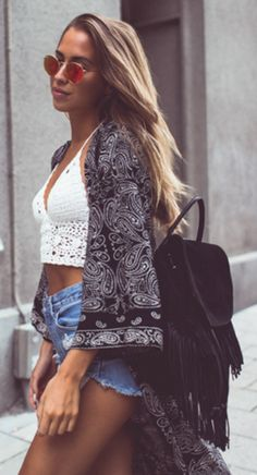 Carry the bohemian trend on into summer with these distressed shorts, crocheted crop top and paisley kimono! Via Kenza Zouiten Top: Chiky, Shorts: Levis, Kimono: Nelly