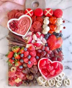 a kids snack board for valentines day is giving us all the feels. This mama sure knows the way to her kids heart! through snacks, obviously. Charcuterie Recipes, Charcuterie And Cheese Board, Valentines Day Food, Holiday Treats, Holiday Recipes, Sharing Platters, Dessert Platter, Hallowen Food, Party Food Platters