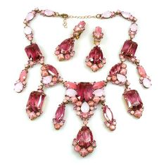 "Exquisite huge bib rhinestone set designed with seven long dangling parts, all in toned in old rose color. Used hand made crystal glass stones with addition of gold and first class Preciosa and Swarovski rhinestones. Length of necklace 15.50"" and extension 2.50"", center part hangs 3.75"", earrings with clips 3.00"""