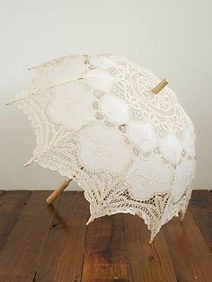 Vintage umbrellas! Too expensive - but the idea of having some stylish umbrellas around if it looks like rain isn't bad