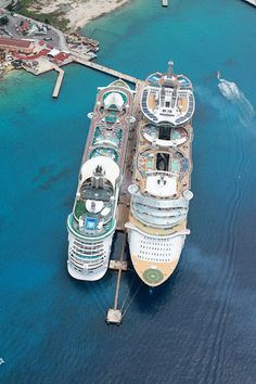 Oasis of the Seas & Freedom of the Seas docked in Cozumel, Mexico. The colors and angles of the ships in these pictures are really something striking to look at.