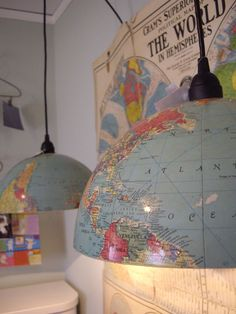 DIY inspiration for a someday room: cover the walls in vintage maps, cut a sepia colored globe in half to make lamps, add a chrome or bronze rim, add a tufted leather couch and/or vintage desk. done.