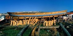Traditional wooden fishing boat repair/building - municipal beach, Nazaré, Portugal, 1969