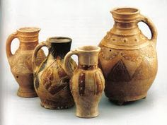 16. Medieval jugs found in SE England, earthenware, thrown, slip decorated, late 12th-early 13th c. Left to right: early 13th-c. made/found in London; mid 13th-century decorated jug made in Kingston; 13th-c. jug made in Rouen, found in Oxfordshire; late 12th-c. incised tripod pitcher made in London. Kingston Jug Medieval, late 13th century, From Kingston, Surrey, England.