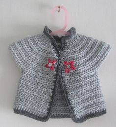 Crochet little girls grey cardigan for all weathers with flower detail.  Age 0 - 9 months