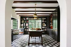I'm completely in love with this space.  The black gloss cabinets, the tile floor, the brass....all of it!