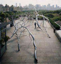 Urban garden. A very Lifelike stainless steal tree sculpture.