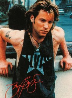 Jon Bon Jovi circa 1992 with a bandage or patch wrapped around his ear (?)