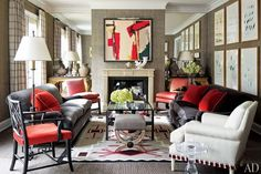 Black or Gray couches, red throw pillows, white furniture accent