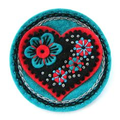 FELT 'LOVE' BROOCH by APPLIQUE-designedbyjane, via Flickr. All her badges are just amazing.