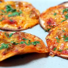 "Tortilla Pizzas When I asked a friend with two young daughters what they like to eat she answered in just one word: ""Cheese!"" ""Not peanut butter and jelly?"" ""Just cheese!"" ""Apples and oranges?"" ""Only cheese. Sometimes tacos."" Ladies, this one is for you.  What you need:  Small corn tortillas Salsa Shredded cheddar cheese  For the full recipe: 32 Healthy Kids Snacks - parenting.com"
