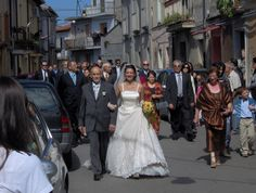 The bride is going to reach the Church for her wedding. We are in Southern Italy, in Drapia (VV), and it's a common tradition to reach the Church by walking with friends and relatives following you! Indulge in an Italian wedding. This can be your dream!