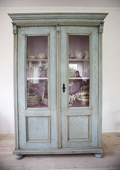 "Painted antique cabinet. Design tip from Carolyn: ""this style is so versatile & adaptable as a bookcase, china cabinet, linen press, or armoire and mixes with many other styles new, vintage or antique."""