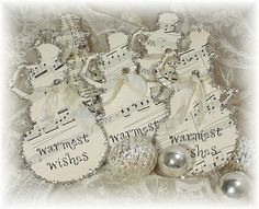 Tim Holtz snowman diecuts with tinsel trim and sheet music - beautiful- Trash to treasure art blog