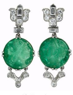 Deco platinum, carved emerald, diamond earrings attributed Mauboussin, ca. 1928 Platinum and diamond lotus blossom motif link followed by round carved emerald cameo, prong set diamond accented 'V' shaped link to finish.