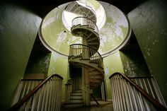 In state of decay. Spiral staircase at the abandoned Western State Hospital, Washington.