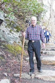 Lawrence Haynes, 90, is greeted with birthday wishes as he hikes Jomeokee Trail at Pilot Mountain State Park.