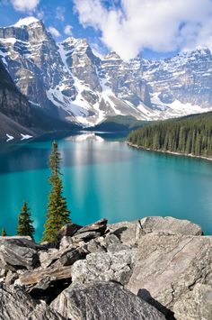 One of the most photographed lakes in the world...Set in the rugged Valley of the Ten Peaks, Moraine Lake is surrounded by mountains, waterfalls, and rock piles, creating a scene so stunning it almost seems unreal.