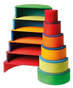 Tiny tots will enjoy sorting the 11 semi-circle pieces by size to make a rainbow and older children can use them to create beautiful patterns and designs. Combine with the Grimm's Large Rainbow for an extra-special toy set and make your own dolls' house. Arco Iris Waldorf, Ciel Pastel, Grands Arcs, Circle Rainbow, Grimms Rainbow, Little Architects, Birch Ply, Ply Wood, Wooden Rainbow