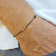 Mens minimalist bracelet with gold beads. Looks great and the strong waterproof cord holds up to wear! Simple Bracelets, Cord Bracelets, Bracelets For Men, Minimalist Necklace, Minimalist Jewelry, Chakra Bracelet, Diffuser Necklace, Adjustable Bracelet, Gold Beads