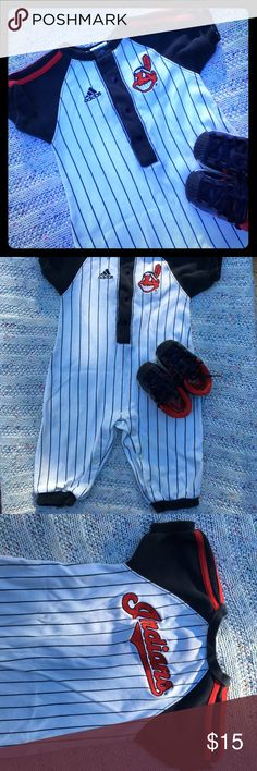 EUC Adidas MLB Cleveland Indians One-Piece Sz 12M Adorable Adidas Cleveland Indians One-Piece Outfit. White w/navy blue pinstripes. Navy short-sleeves w/ signature Adidas triple stripes.  Navy trim at the ankle, Indian mascot on front left shoulder & Indians written across the back. No rips or holes...One very faint spot on back leg & slight discoloration around the snaps. None of flaws are noticeable. Please feel free to ask questions...⚾️⚾️⚾️ Adidas One Pieces