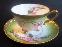 T V Limoges Three Footed Cup & Saucer. Hand Painted with Cherry Blossoms 1907