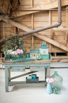 Reynolds Table at Found Vintage Rentals. Industrial wooden table with chippy turquoise paint and two drawers
