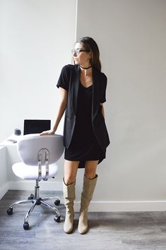 Black dress with tan over the knee boots outfit
