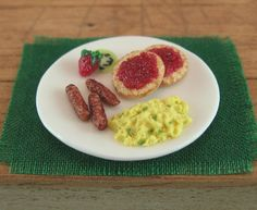 Miniature Breakfast with Scrambled Eggs, Sausages, English Muffin with Strawberry Jam and Fruits