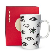 A  ceramic coffee mug with hand-drawn eyes that create a unique pattern. Part of our Dot Collection.