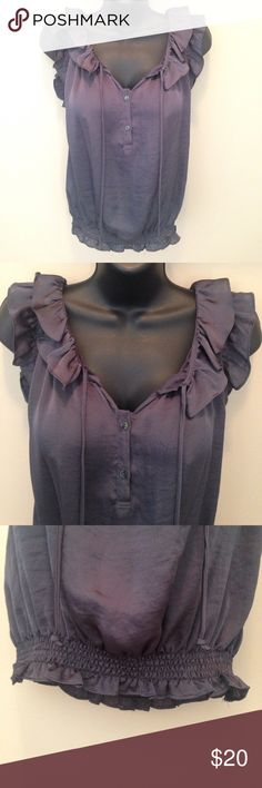 """Charcoal Ruffled Smocked Hem Top Excellent condition.  Adorable trendy ruffles, two buttons and ties at neck, smocked hem, loose fitting. Approx measurements laying flat: chest 19"""", length 22"""". Tops Tank Tops"""