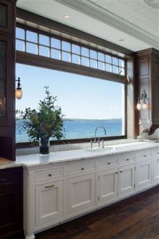 I want to open kitchen window like this to porch. Too bad there is not an ocean to open it to!