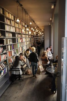 "Great use of a narrow space for books- love the lighting too.   the shop is called ""Merci"" in Paris, photo thanks to @Desiree Nechacov  of Vosages Paris"