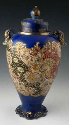 Japanese Satsuma Covered Handled Baluster Urn, late 19th c., with moriage, figural and floral decoration