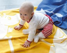 Moomin soft cotton baby blanket, available in yellow blue pink and green from A Swedish Home's website