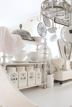 Stunning French white country kitchen with a shabby chic flair - farmhouse kitchen canisters