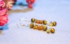 Sea Tiger Earrings Materials used: tiger eye stones and chihimbar chips, inox bolts earrings Materiale folosite: ochi de tigru piatra si chihimbar chips, inchizatoare cerceci inox #joyfactorytsa #handmade #socialproject #fabricadebucurii #salvationarmy #salvationarmyprojects #armatasalvariibucuresti #charity #beadedjewerly #jewelry #salvationarmybucharest #handmadejewelry #salvationarmysupport #ochidetigru #piatraochidetigru #chihimbar #chipschihimbar #stonesjewerly #earrings #inoxjewerly