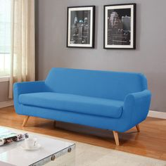 This mid-century 3 seater loveseat is just what you need to give your living room or bedroom a pop modernism. This fun design is to give your traditional rooms a more contemorary look. Featuring hardw