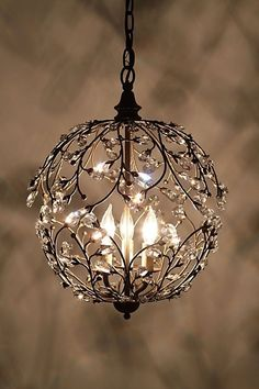 """Lambent Sphere Chandelier I'm not a big fan of the whole """"a chandelier in every room"""" movement (in the bathroom? a chandelier?) - too formal and forced for me. Home Lighting, Chandelier Lighting, Pendant Chandelier, Round Chandelier, Hanging Chandelier, Simple Chandelier, Small Chandeliers, Bedroom Chandeliers, Modern Lighting"""