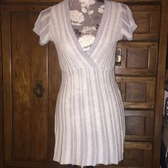 Charlotte Russe long dress shirt/ top medium Shimmery V neck long shirt or short dress with metallic cream and gray stripes. Falls just below the hip line making it a perfect choice to pair with a fun bright pair of leggings/ tights or your favorite pair of skinny jeans. Gently worn. No signs of wear. Accessories pictured with top are not included with purchase, just for style ideas. Charlotte Russe Tops Tunics