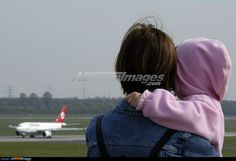 visitors enjoying the view of aircraft from the observation deck