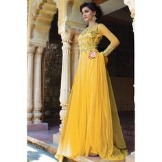 Get ready to mesmerize the world by wearing this amazing Lemon Yellow Pure Net Designer Anarkali Gown.