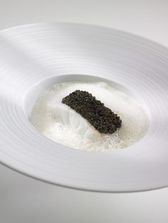 Anne-Sophie Pic a snowy filet of sea bass topped with Aquitaine caviar
