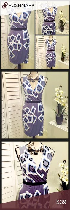 NWT Elegant geometric Print Mini Dress NWT Elegant Geometric print style Mini Dress in different tones of lavender blue, baby blue & Black, this dress is very  pretty & stylish 👗it is right above the knee. New York & Company Dresses Mini