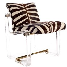 Lucite Chair with Brass accents, upholstered with chocolate and cream stenciled cowhide. (=)