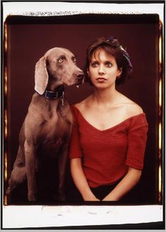 William Wegman photographs, Fay and Andrea (1987). One of William Wegman's Weimaraners in a polite Polaroid moment with studio assistant Andrea Beeman.