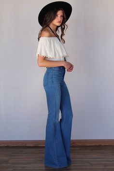 Bell bottoms first appeared in the 1970's, but has recently come back into popularity. You can find them online and in numerous department stores. The most popular fit is high waisted like shown here and paired with a crop top. 2/21/16 https://www.pinterest.com/explore/bell-bottom-pants/