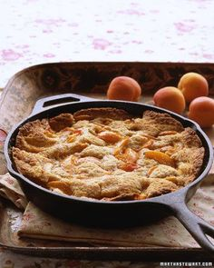 Apricot-Almond Cobbler Cobbler is a fruit dessert with a thick top layer of crust. In this version of the classic, spiced apricot wedges are arranged atop a toasted-almond batter. Baking puffs up the cake, so only bits of fruit peek through. Köstliche Desserts, Delicious Desserts, Dessert Recipes, Yummy Food, Fruit Dessert, Quick Dessert, Dessert Party, Fruit Cakes, Apricot Cobbler